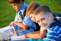 Kids. With books sitting in park Royalty Free Stock Photo