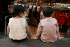 Kids. Two little chinese kids sitting next to each other Stock Photo