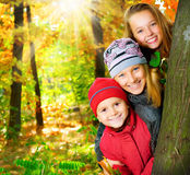 Kids. Happy Kids Having Fun in Autumn Park. Outdoors Royalty Free Stock Photo