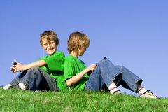 Kids. Twin boys, kids , children friends playing outdoors in summer Royalty Free Stock Photos