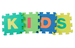 Kids. Alphabet blocks forming the word KIDS isolated on white background Stock Photography
