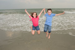 Kids. Happy Kids Jumping for Joy at the beach Royalty Free Stock Photo