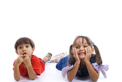 Kids. Two cute kids lying on white background stock photos