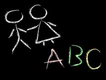 Kids and abc on chalkboard Stock Images