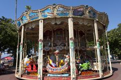 Grand Carousel at la Croisette boulevard in Cannes. Kids activities at la Croisette boulevard in Cannes - Grand Carousel royalty free stock photography