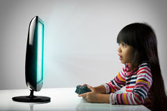 Kids addicted to the game. Little girl playing computer games, Kids addicted to the game concept royalty free stock photo