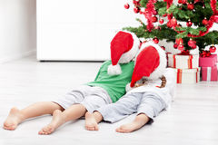 Kids admiring the christmas tree Royalty Free Stock Image