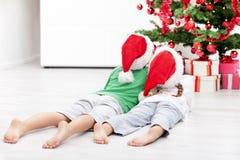 Kids admiring the christmas tree Royalty Free Stock Image
