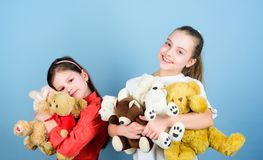 Kids adorable cute girls play soft toys. Happy childhood. Child care. Sisters best friends play. Sweet childhood stock photos