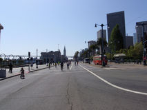 Kids and adults bike on the Embarcadero road at Sunday Streets Royalty Free Stock Images