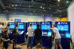 Kids and adults playing PS 4 game consoles Royalty Free Stock Photography