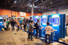 Kids and adults playing WII U game consoles. STRASBOURG, FRANCE - MAY 8, 2015: Kids and adults playing WII U game consoles at the open market Digital Game Manga Stock Photo