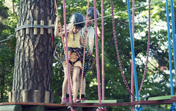 Kids in adventure park. (canopy park royalty free stock images