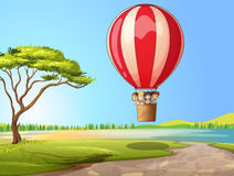 Kids in a air balloon Royalty Free Stock Image
