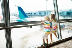 Kids travel and fly. Child at airplane in airport Stock Image