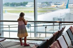 Kids travel and fly. Child at airplane in airport royalty free stock photos