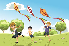 Kids with alphabet kites Stock Photos