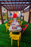 Kids American Theme Birthday Party. Setting of themed kids birthday party that's outdoors for 2 year old babies Stock Photos