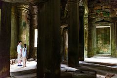 Kids at Angkor Wat temple. Kids at ancient Angkor Wat temple in Siem Reap in Cambodia royalty free stock photos