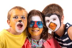 Kids with animal face-paint stock images
