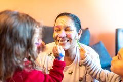 Children applying make up to grandmother. royalty free stock image