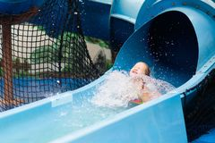 Kids at aqua park. Child in swimming pool. Kids play in aqua park. Children at water playground of tropical amusement park. Little girl at swimming pool. Child royalty free stock photo