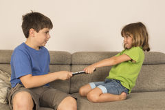 Kids arguing for playing with a digital tablet Stock Photo