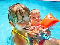 Kids with armbands in swimming pool. Stock Images