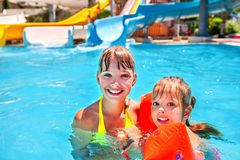 Kids with armbands in swimming pool Stock Photography