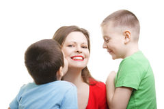 Kids around mommy Stock Image