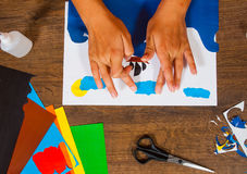 Kids art. Crafts concept. Handmade. on wooden table top view. Child Glues of paper. Sheets of colored paper. Kids art. Crafts concept. Handmade. on wooden table royalty free stock image