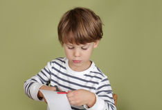 Kids Arts and Crafts Activity Child Learning to Cut with Scissor Stock Photography