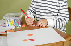 Kids Arts and Crafts Activity, Learning and Education. Child, kid engaged in arts and crafts activity, creative learning and education concept royalty free stock images