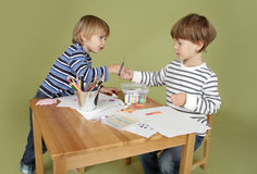 Kids Arts and Crafts Activity, Sharing. Child, kid engaged in arts and crafts activity, sharing and learning concept royalty free stock photo
