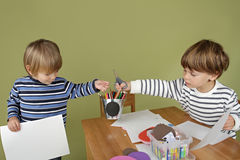 Kids Arts and Crafts Activity, Sharing and Playing Together. Child, kid engaged in arts and crafts activity, sharing and playing nice together stock image
