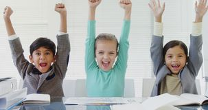 Kids as business executive smiling with their arms up 4k stock footage