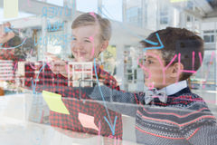 Kids as business executives discussing over whiteboard. In office royalty free stock photography