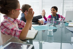 Kids as business executives interacting while meeting. In conference room stock photo