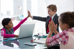 Kids as business executives interacting while meeting. In conference room stock photos