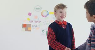 Kids as business executives shaking hands 4k. Kids as business executives shaking hands in office 4k stock video footage
