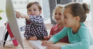 Kids as business executives working on computer 4k