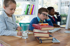 Kids as business executives working together. In office stock images