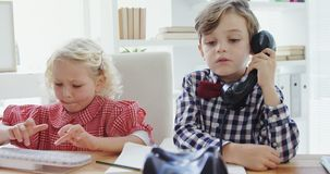 Kids as business executives working together 4k. Kids as business executives working together in office 4k stock footage