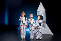 Kids in astronaut costumes Stock Images
