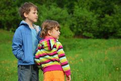 Kids At Green Meadow Near Forest Royalty Free Stock Photo