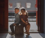 Free Kids At The Train Station On The Suitcases. Royalty Free Stock Image - 162817536