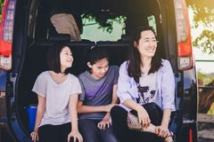 Kids and Auntie relax on car after long trip. To the sea stock image