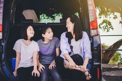 Kids and Aunty relax on car. After long trip royalty free stock photography