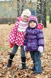 Kids in autumn Stock Photos
