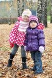 Kids in autumn Stock Photos